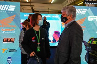 MIE Racing Honda team owner Midori Moriwaki and FIM President Jorge Viegas